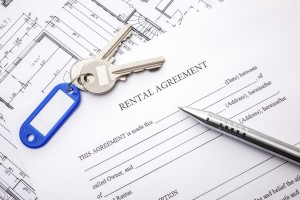 Rental agreement document with keys and pencil